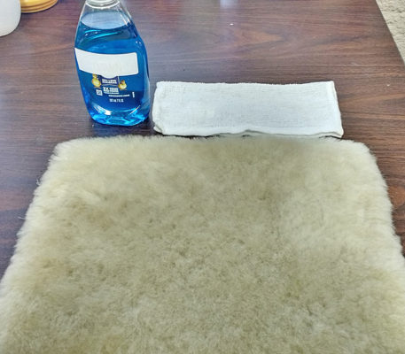dish soap and hand towel for cleaning sheepskin